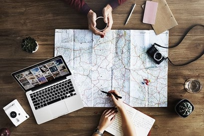 People making travel plans using the map
