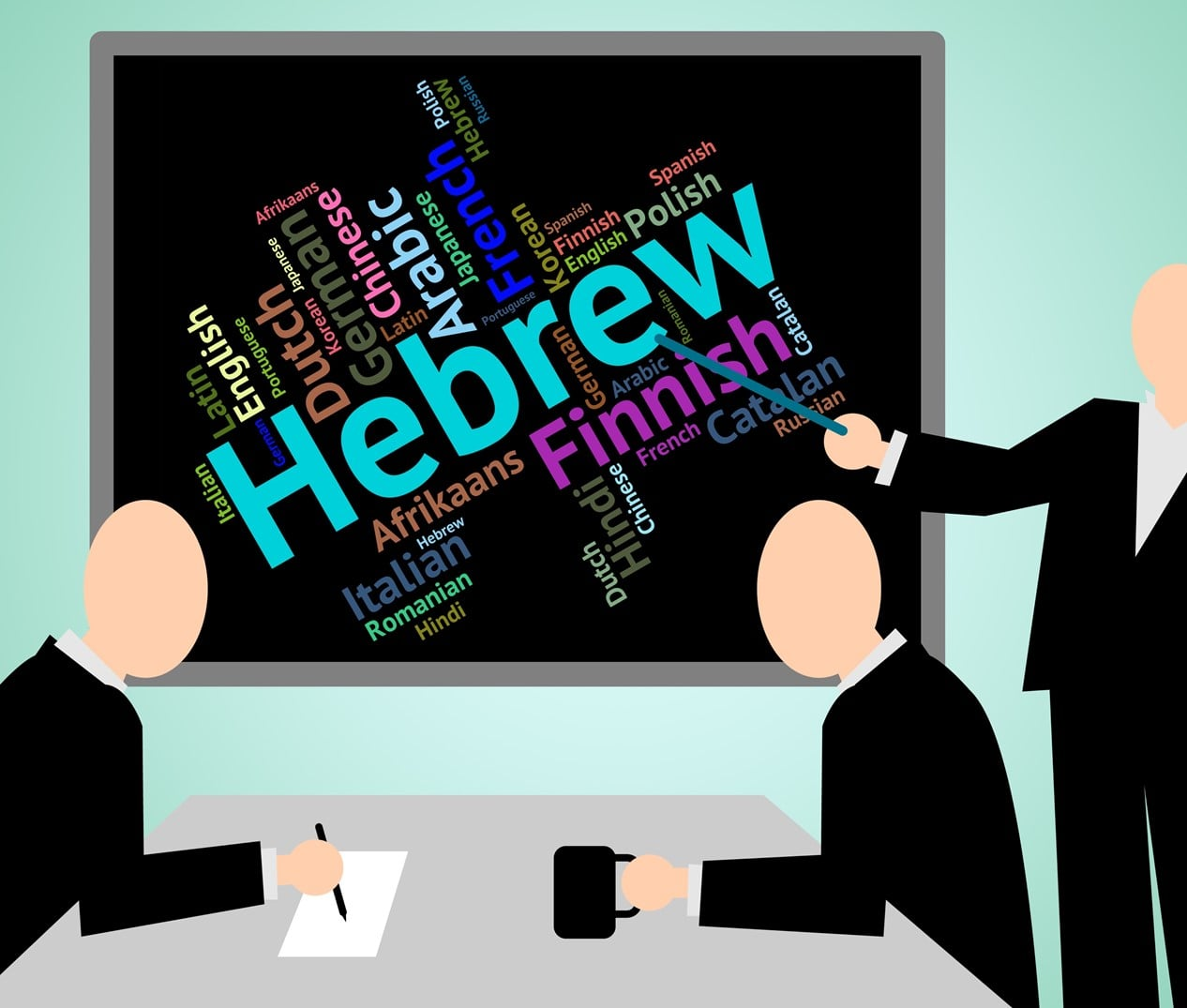 Man pointing to Hebrew on a blackboard