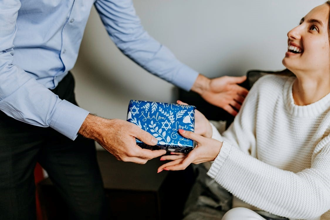 A man giving a gift to a woman
