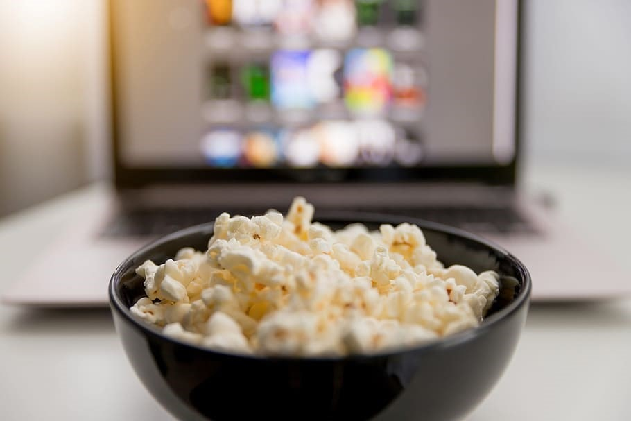 Popcorn-in-front-of-a-laptop-with-movie-selections