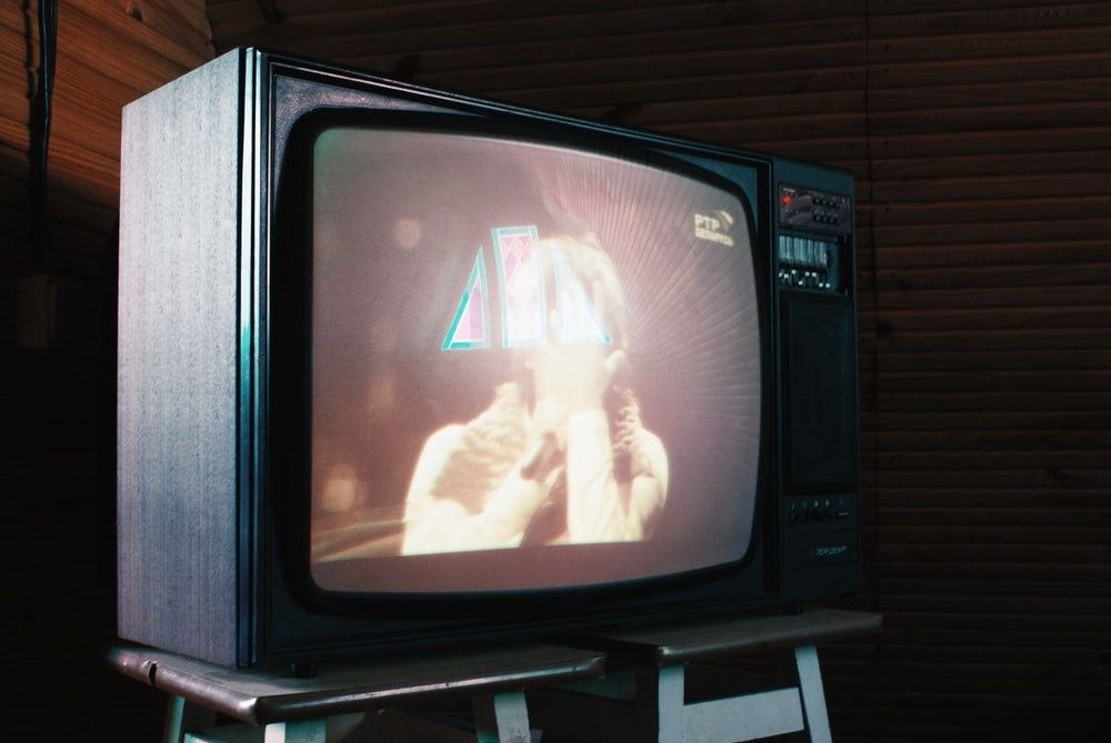 An old television set playing shows